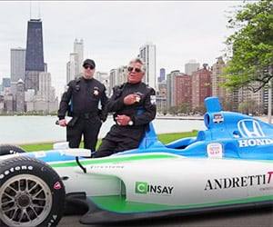 mario andretti hands out slowness citations. Black Bedroom Furniture Sets. Home Design Ideas