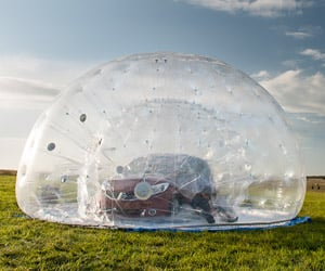 Nissan Rolls Car Down Hill in Giant Zorb Ball