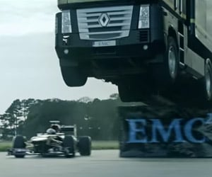 Truck Jumps over Speeding Formula 1 Race Car