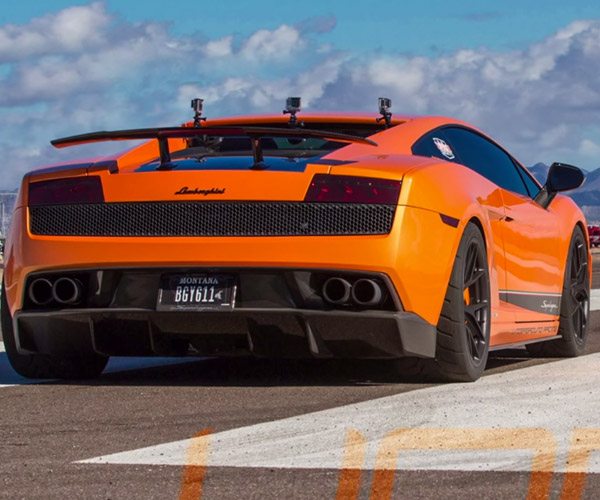 Twin Turbo Lambo Destroys Bugatti Veyron in 1/2-Mile
