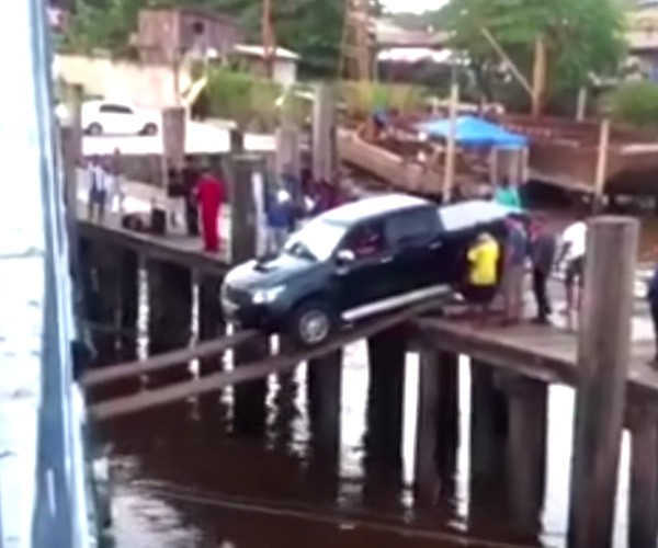 Insane Driver Uses Flimsy Boards to Load Truck onto Ship