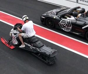 A Snowmobile Drag Races Against Ferraris