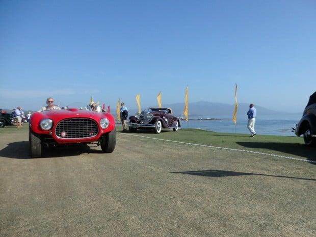 Ferrari and Duesenberg leaving the show