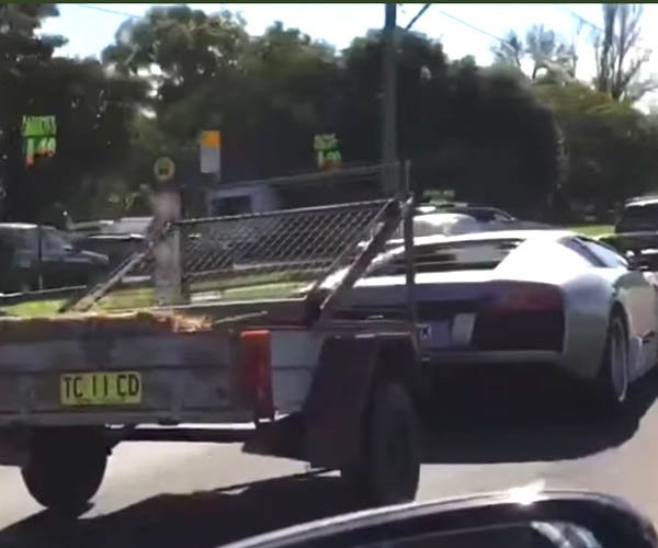 Just a Lamborghini Towing a Goat Cart