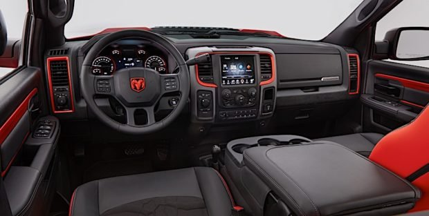 The Macho Mango exterior color of the Ram Macho Power Wagon also brightens the interior, accenting the steering wheel Ram logo and the trim on the gauges, HVAC, infotainment center and side door panels.